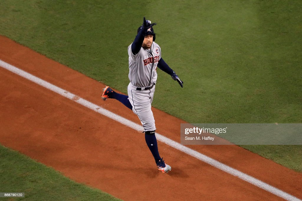 George Springer #4 of the Houston Astros celebrates as he runs the bases after hitting a solo home run during the third inning against the Los Angeles Dodgers in game six of the 2017 World Series at Dodger Stadium on October 31, 2017 in Los Angeles, California.