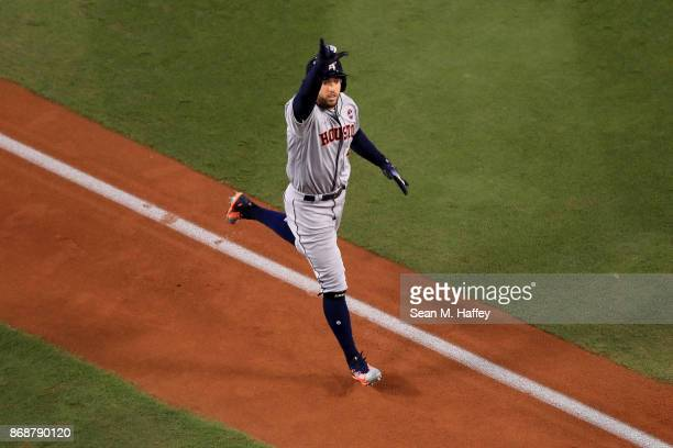George Springer of the Houston Astros celebrates as he runs the bases after hitting a solo home run during the third inning against the Los Angeles...