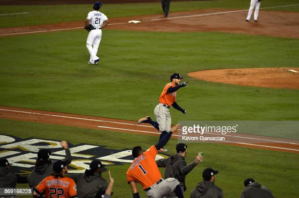 George Springer of the Houston Astros celebrates as he runs the bases after hitting a tworun home run during the second inning against the Los...