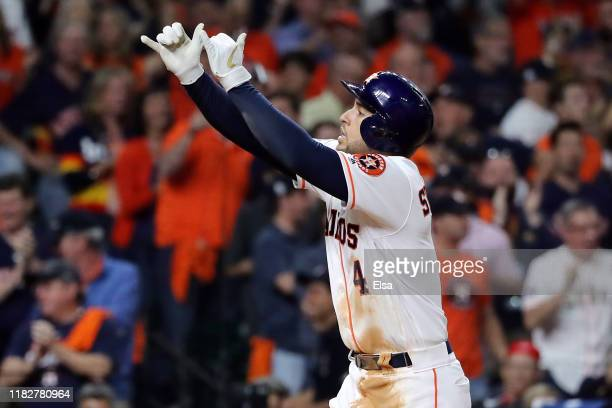 George Springer of the Houston Astros celebrates his solo home run against the Washington Nationals during the seventh inning in Game One of the 2019...