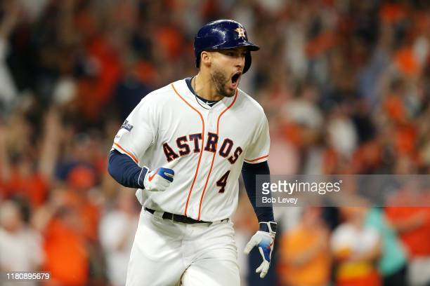 George Springer of the Houston Astros celebrates hitting a solo home run during the fifth inning against the New York Yankees in game two of the...