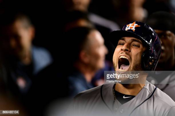 George Springer of the Houston Astros celebrates in the dugout after hitting a tworun home run during the eleventh inning against the Los Angeles...