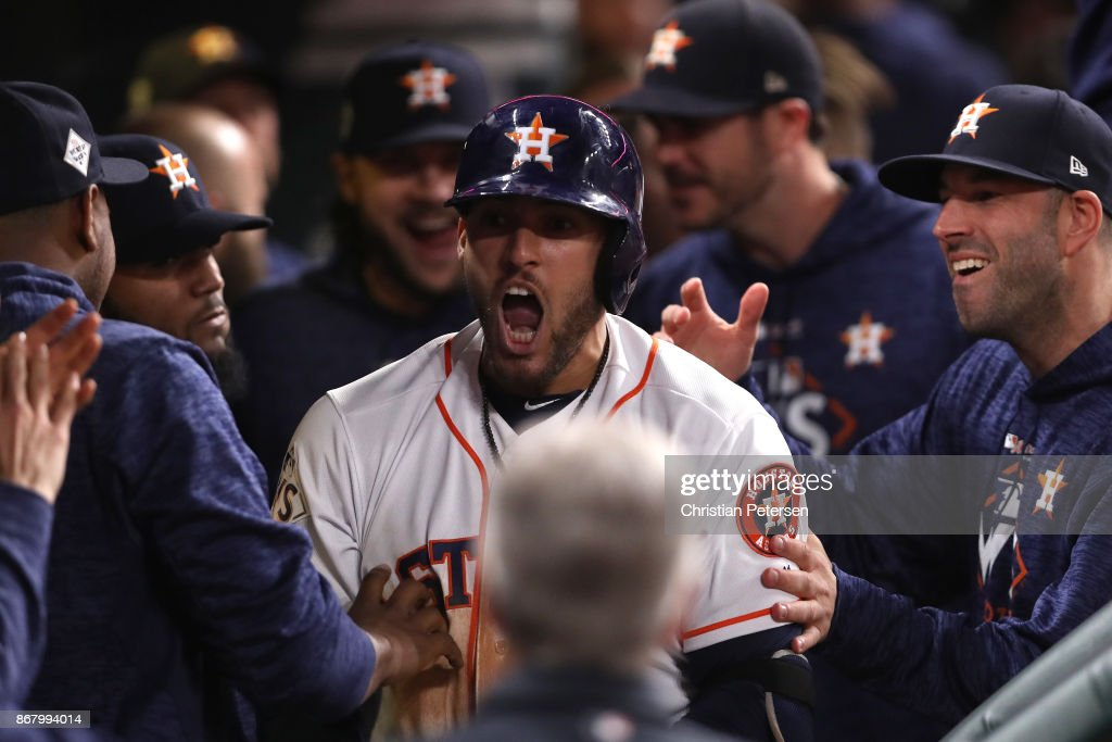 George Springer #4 of the Houston Astros celebrates in the dugout with teammates after a solo home run during the seventh inning against the Los Angeles Dodgers in game five of the 2017 World Series at Minute Maid Park on October 29, 2017 in Houston, Texas.