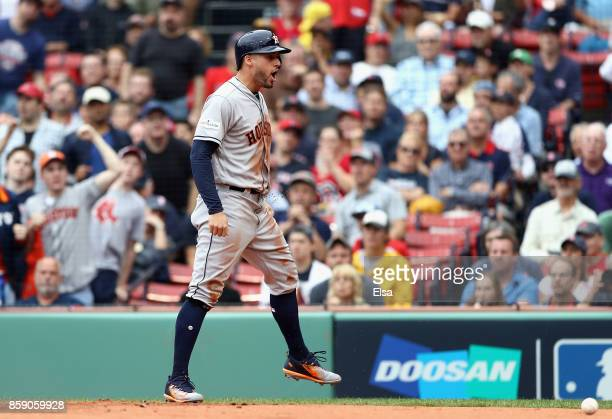 George Springer of the Houston Astros celebrates scoring a run in the first inning against the Boston Red Sox during game three of the American...