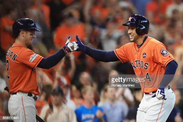 George Springer of the Houston Astros celebrates with Alex Bregman after hitting a solo home run in the third inning against the Boston Red Sox...
