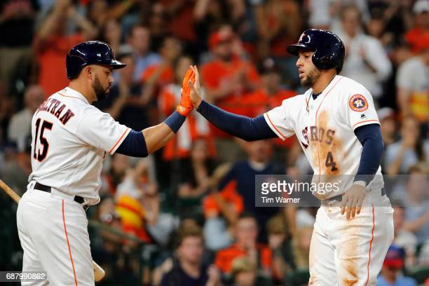 George Springer of the Houston Astros celebrates with Carlos Beltran after scoring a run in the third inning against the Detroit Tigers at Minute...