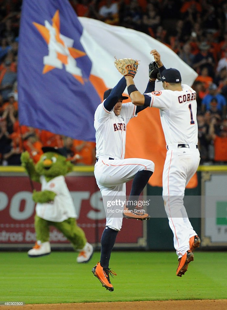 George Springer #4 of the Houston Astros celebrates with Carlos Correa #1 of the Houston Astros after the Houston Astros defeat the Kansas City Royals in game three of the American League Division Series at Minute Maid Park on October 11, 2015 in Houston, Texas. The Houston Astros defeated the Kansas City Royals with a score of 4 to 2.