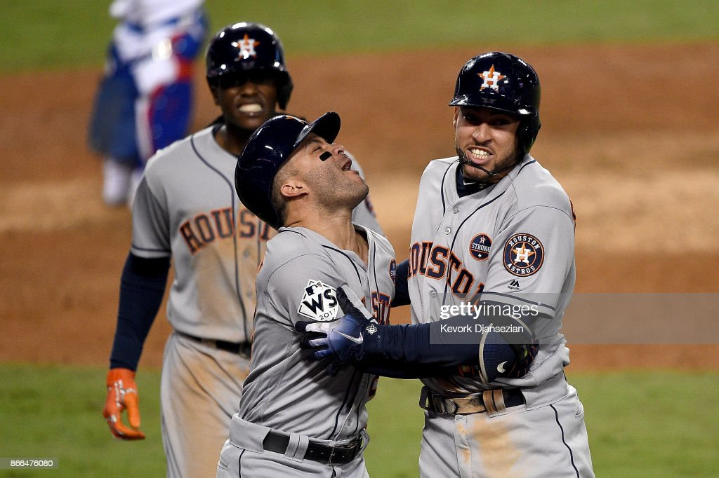 George Springer #4 of the Houston Astros celebrates with Jose Altuve #27 after hitting a two-run home run during the eleventh inning against the Los Angeles Dodgers in game two of the 2017 World Series at Dodger Stadium on October 25, 2017 in Los Angeles, California.