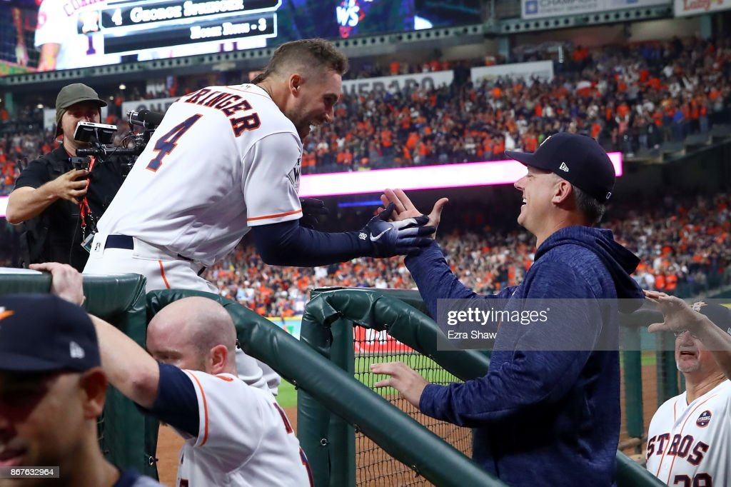George Springer #4 of the Houston Astros celebrates with manager manager A.J. Hinch #14 after hitting a solo home run during the sixth inning against the Los Angeles Dodgers in game four of the 2017 World Series at Minute Maid Park on October 28, 2017 in Houston, Texas.