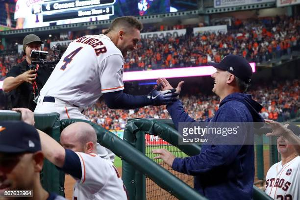 George Springer of the Houston Astros celebrates with manager manager AJ Hinch after hitting a solo home run during the sixth inning against the Los...