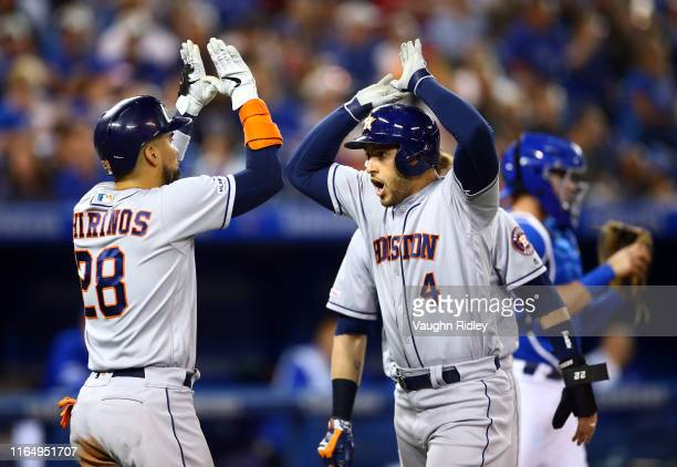 George Springer of the Houston Astros celebrates with Robinson Chirinos after hitting a 3 run home run in the fifth inning during a MLB game against...