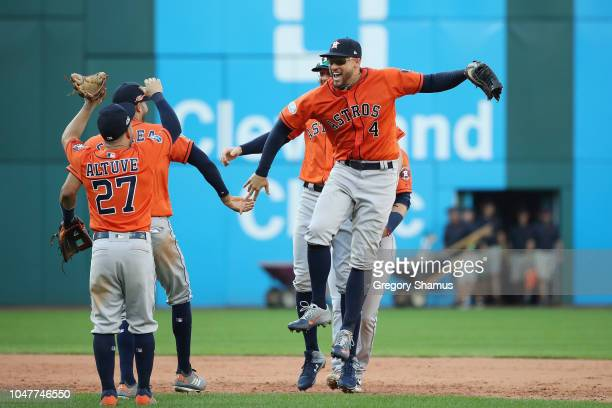 George Springer of the Houston Astros celebrates with teammates after defeating the Cleveland Indians 11-3 in Game Three of the American League...