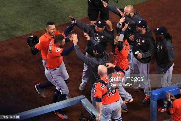 George Springer of the Houston Astros celebrates with teammates after hitting a tworun home run during the second inning against the Los Angeles...