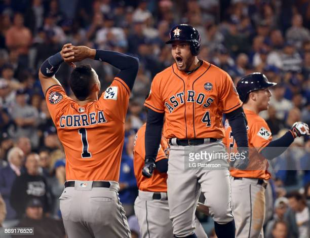 George Springer of the Houston Astros celebrates with teammates after hitting a tworun home run in the second inning of Game 7 of the 2017 World...