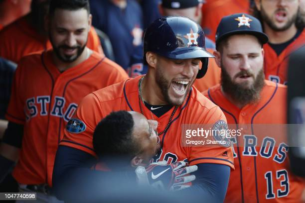 George Springer of the Houston Astros celebrates with Tony Kemp after hitting a solo home run in the eighth inning against the Cleveland Indians...