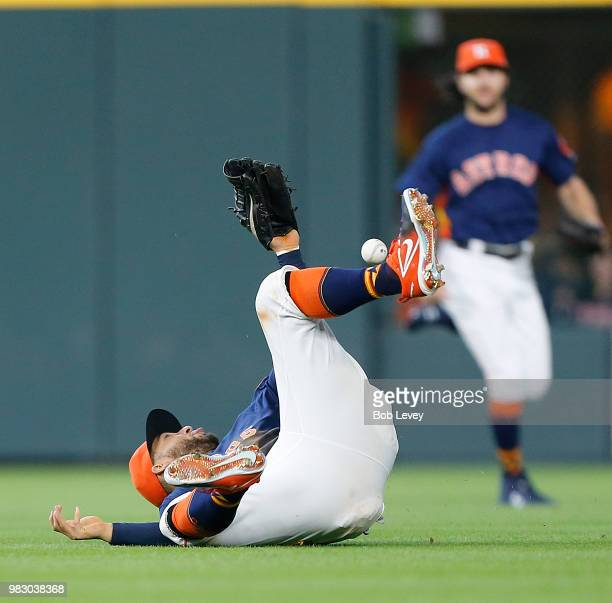 George Springer of the Houston Astros comes up short as he dives for ball off the bat of Lucas Duda of the Kansas City Royals in the eighth inning at...