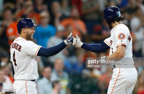 George Springer of the Houston Astros congratulates Jake Marisnick after his home run against the Los Angeles Angels of Anaheim in the seventh inning...