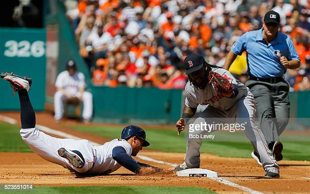 George Springer of the Houston Astros dives back into first base as Hanley Ramirez of the Boston Red Sox takes the throw at Minute Maid Park on April...