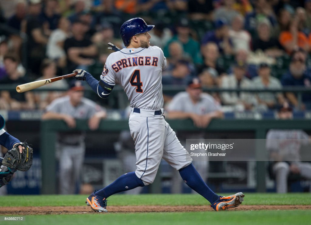 George Springer #4 of the Houston Astros hits a one-run single off of relief pitcher Nick Vincent #50 of the Seattle Mariners to score Marwin Gonzalez #9 of the Houston Astros during the seventh inning of a game at Safeco Field on September 6, 2017 in Seattle, Washington.