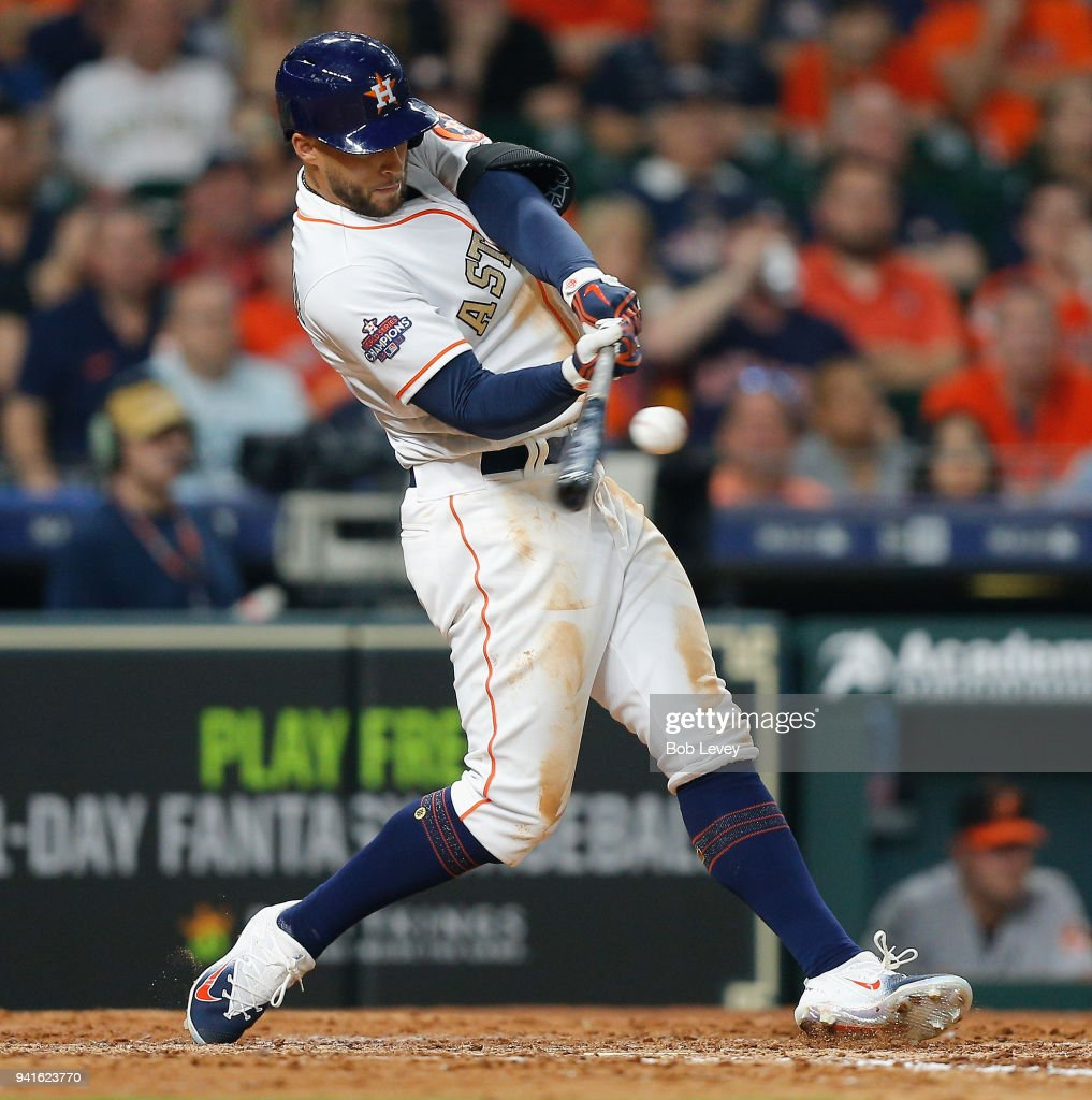 George Springer #4 of the Houston Astros hits a rbi double in the seventh inning against the Baltimore Orioles at Minute Maid Park on April 3, 2018 in Houston, Texas.