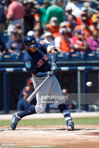 George Springer of the Houston Astros hits a single during the first inning of the Spring Training game against the Washington Nationals at FITTEAM...