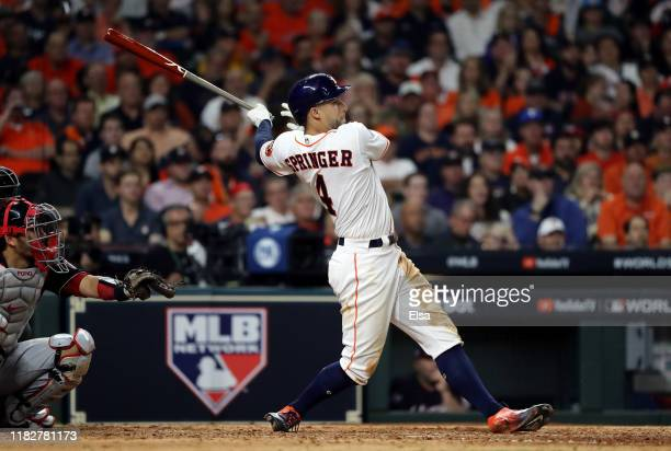 George Springer of the Houston Astros hits a solo home run against the Washington Nationals during the seventh inning in Game One of the 2019 World...
