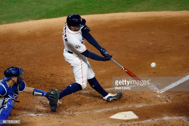 George Springer of the Houston Astros hits a solo home run during the sixth inning against the Los Angeles Dodgers in game four of the 2017 World...