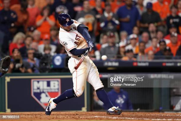 George Springer of the Houston Astros hits a solo home run during the seventh inning against the Los Angeles Dodgers in game five of the 2017 World...
