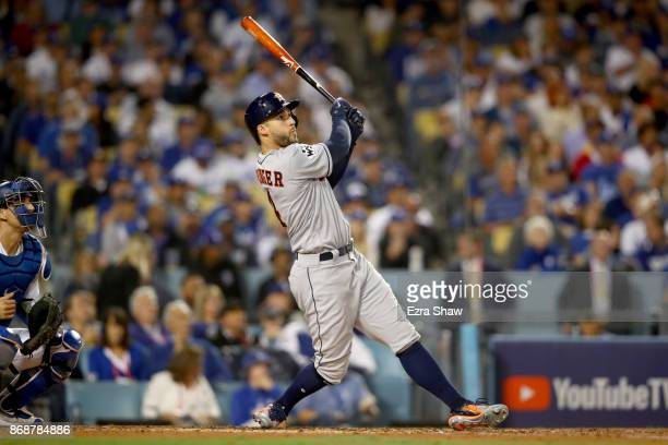 George Springer of the Houston Astros hits a solo home run during the third inning against the Los Angeles Dodgers in game six of the 2017 World...