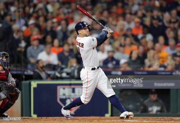 George Springer of the Houston Astros hits a solo home run in the third inning against the Boston Red Sox during Game Four of the American League...