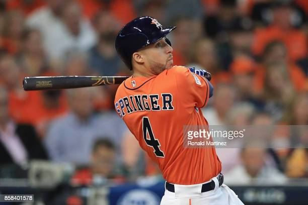 George Springer of the Houston Astros hits a solo home run in the third inning against the Boston Red Sox during game two of the American League...