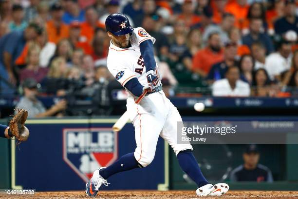 George Springer of the Houston Astros hits a solo home run off Corey Kluber of the Cleveland Indians in the fifth inning during Game One of the...