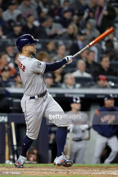 George Springer of the Houston Astros hits a threerun home run against the New York Yankees during the third inning in game four of the American...