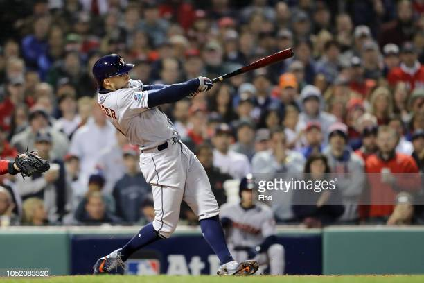 George Springer of the Houston Astros hits a two RBI single during the second inning against the Boston Red Sox in Game One of the American League...