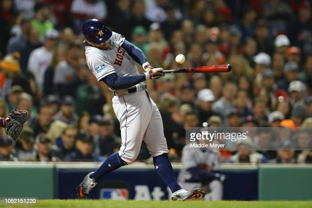 George Springer of the Houston Astros hits a two run double during the second inning against the Boston Red Sox in Game Two of the American League...