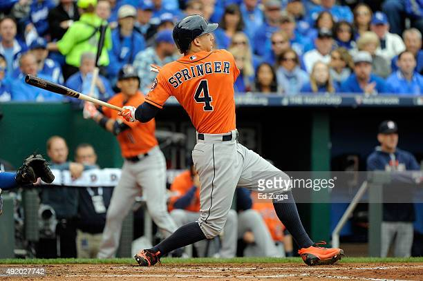 George Springer of the Houston Astros hits a two run single against Johnny Cueto of the Kansas City Royals in the second inning during game two of...