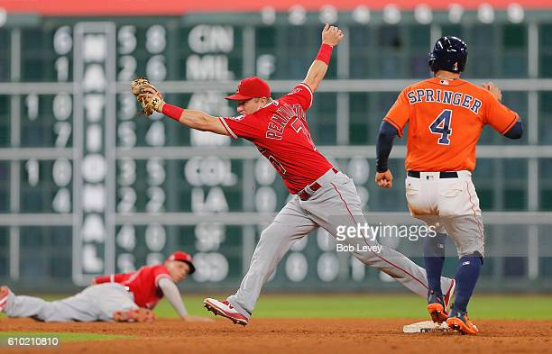 George Springer of the Houston Astros i0s forced out at second base as Cliff Pennington of the Los Angeles Angels of Anaheim takes the throw in the...