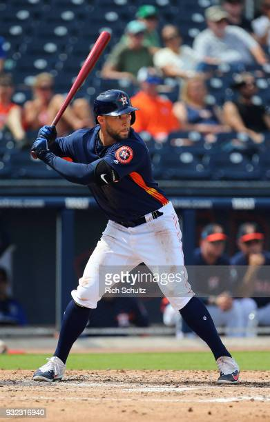 George Springer of the Houston Astros in action against the Miami Marlins during a spring training game at Fitteam Ballpark of the Palm Beaches on...
