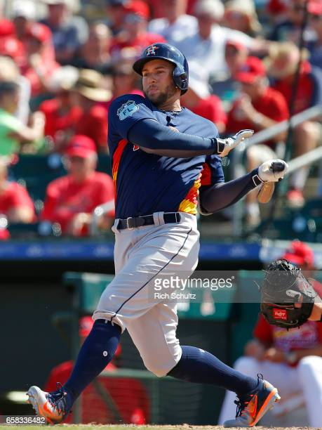 George Springer of the Houston Astros in action against the St Louis Cardinals during a spring training game at Roger Dean Stadium on March 9 2017 in...