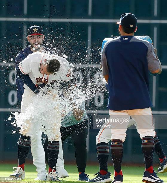 George Springer of the Houston Astros is doused with water after hitting a game winning single in the tenth inning against the Los Angeles Angels of...