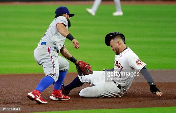 George Springer of the Houston Astros is tagged out by Rougned Odor of the Texas Rangers attempting to steal second base in the first inning at...