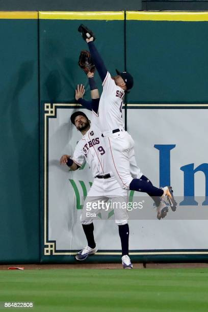 George Springer of the Houston Astros makes a catch at the wall over Marwin Gonzalez hit by Greg Bird of the New York Yankees during the seventh...