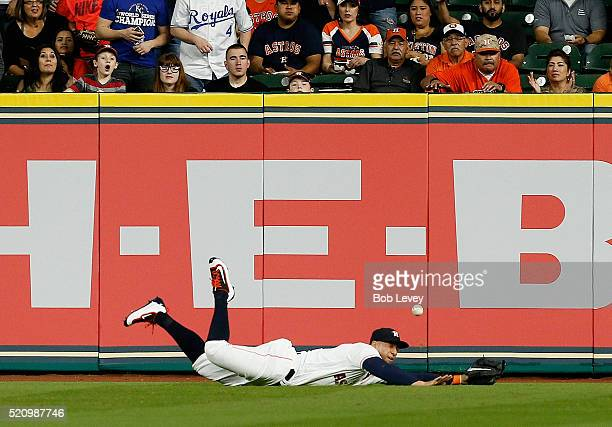 George Springer of the Houston Astros makes a diving attempt at a line drive by Mike Moustakas of the Kansas City Royals in the first inning at...