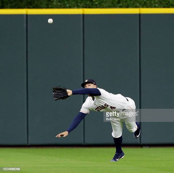 George Springer of the Houston Astros makes a diving catch on a ball off the bat of Khris Davis of the Oakland Athletics in the first inning at...
