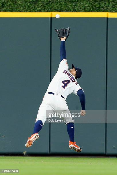 George Springer of the Houston Astros makes a running overtheshoulder catch on line drive off the bat of Yangervis Solarte of the Toronto Blue Jays...