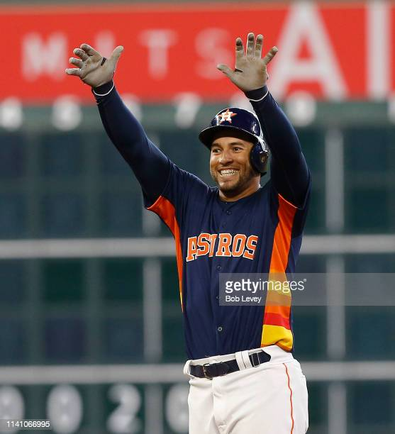 George Springer of the Houston Astros motions to the bench after hitting a double in the eighth inning against the Oakland Athletics at Minute Maid...