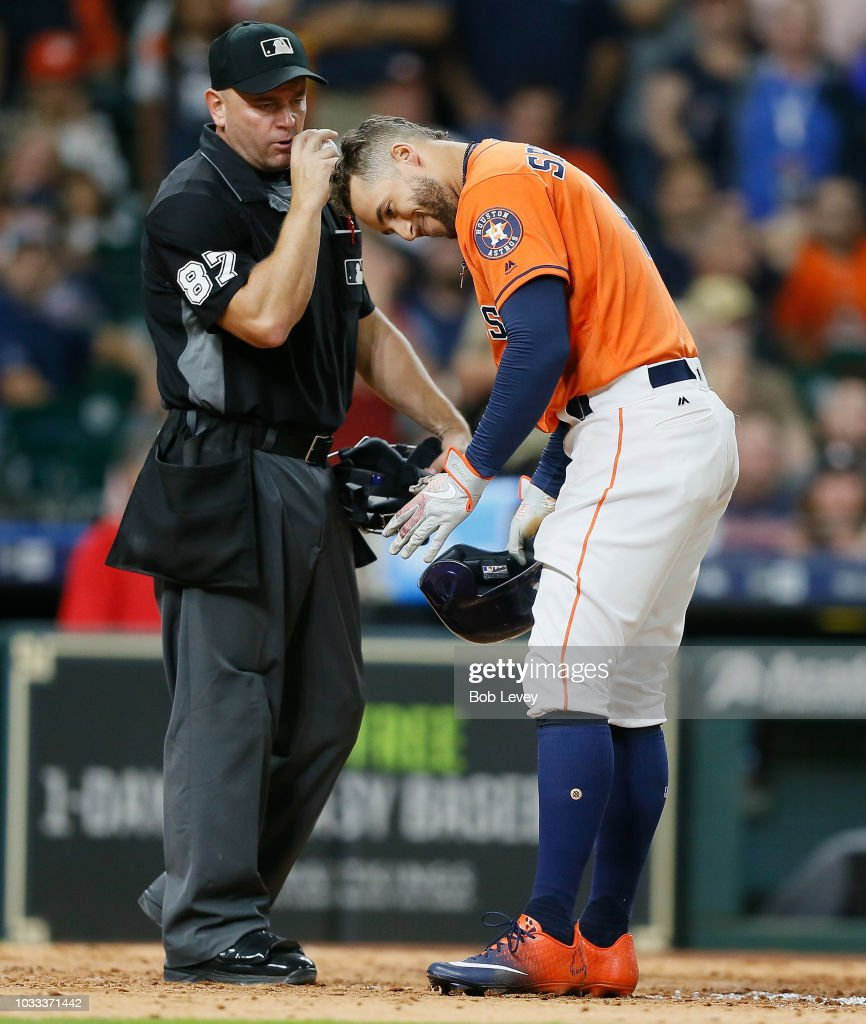 George Springer #4 of the Houston Astros reacts after being called out on strikes by home plate umpire Scott Barry #87 in the seventh inning at Minute Maid Park on September 14, 2018 in Houston, Texas.