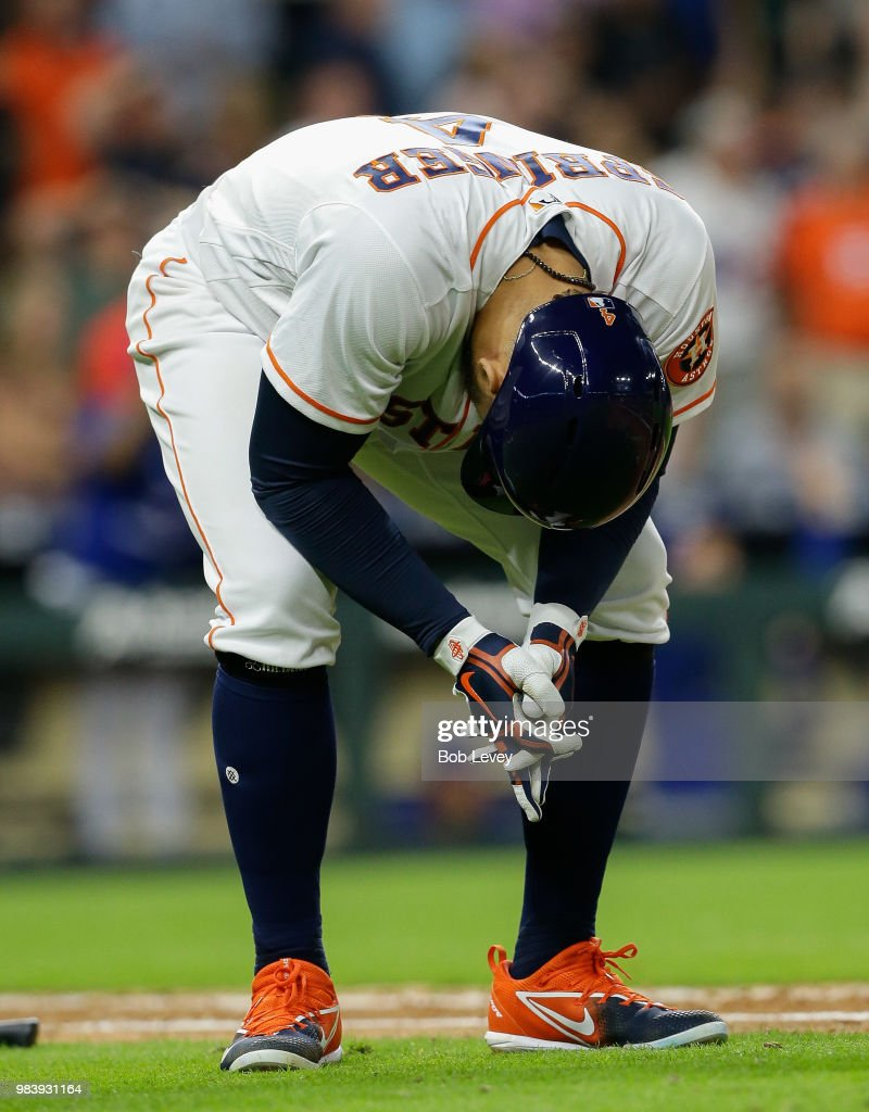 George Springer #4 of the Houston Astros reacts after his fly ball was caught at he wall by Randal Grichuk #15 of the Toronto Blue Jays to take away a three run home run in the ninth inning at Minute Maid Park on June 25, 2018 in Houston, Texas.