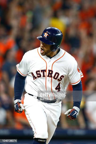 George Springer of the Houston Astros reacts after hitting a solo home run off Corey Kluber of the Cleveland Indians in the fifth inning during Game...