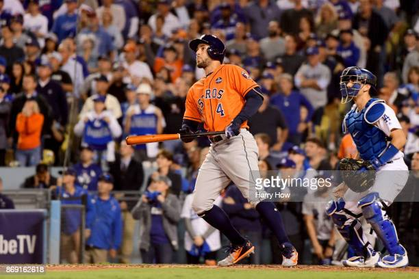 George Springer of the Houston Astros reacts after hitting a tworun home run during the second inning against the Los Angeles Dodgers in game seven...